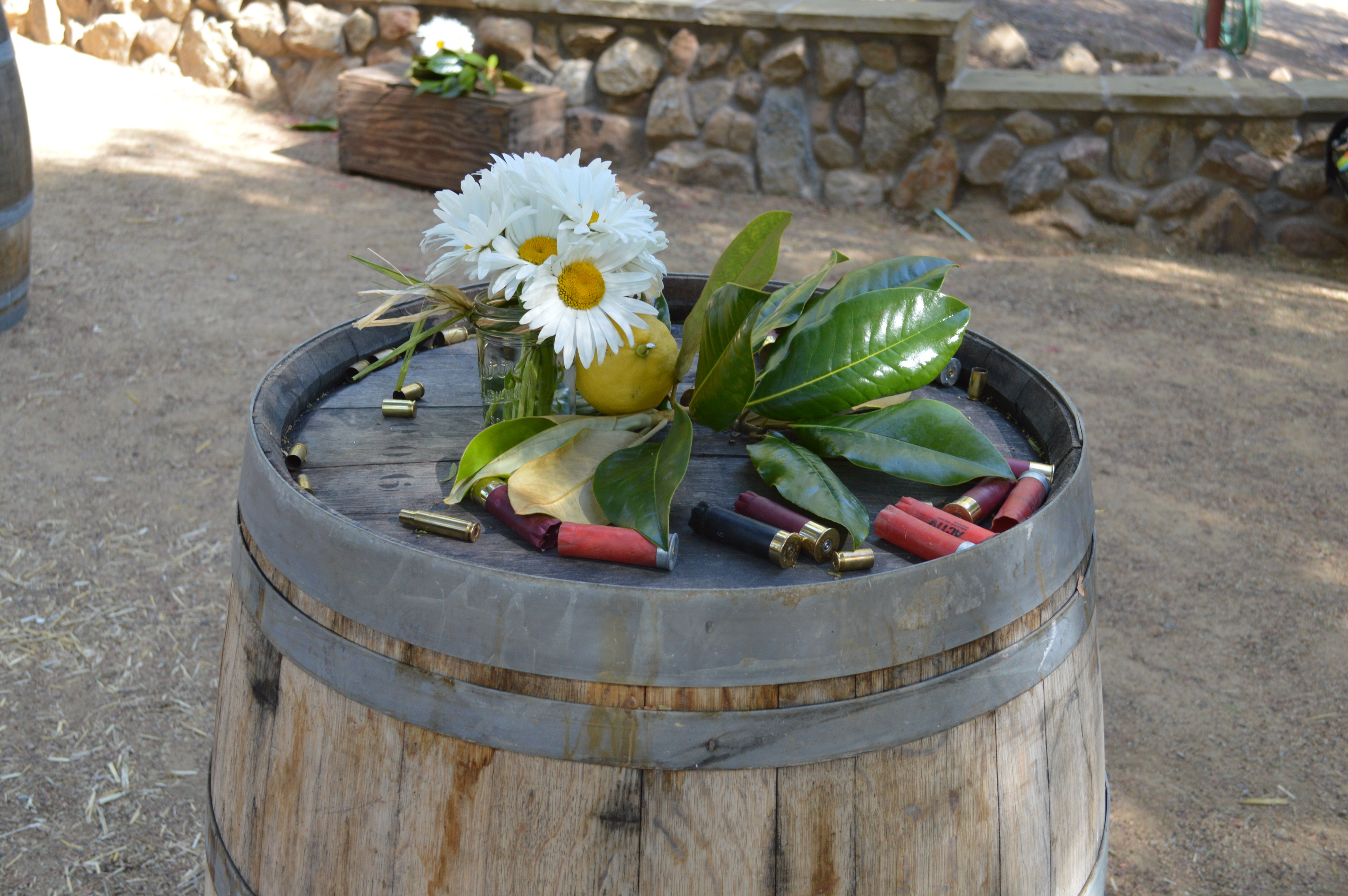 Wine Barrel Bar Table wit Shotgun Shells and Flowers - Country Wedding